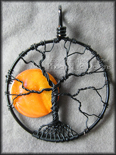 Handmade tree of life pendant in black wire and orange shell bead moon.