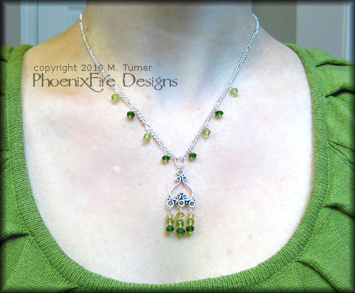 Genuine, AAA quality Chrome Diopside, Micro-faceted Peridot and Imperial Topaz gemstones are featured in this stunning sterling silver necklace.