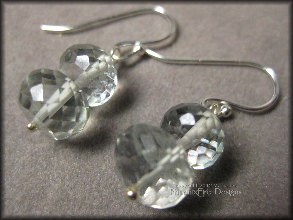 Gorgeous microfaceted mystic quartz rondelles in a beautiful pale mint color are stacked on .925 sterling silver pins and dangle from .925 ear wires.