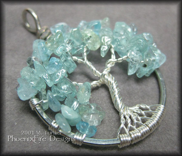 Beautiful, genuine gemstone blue aquamarine - the birthstone of March - brings the color of the sea to the sterling silver wire of this stunning, custom Tree of Life pendant.