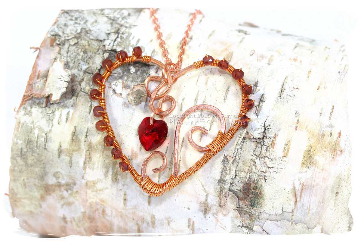 Wire wrapped copper heart pendant by Phoenix Fire Designs with dark red garnet gemstone accents and swarovski crystal heart pendant handmade wire wrap necklace on etsy