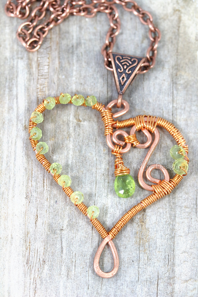 Wire wrapped heart pendant in copper wire with peridot birthstone gemstones, Celtic design bail and antique copper chain with spirals and swirls handmade by PhoenixFire Designs on etsy.