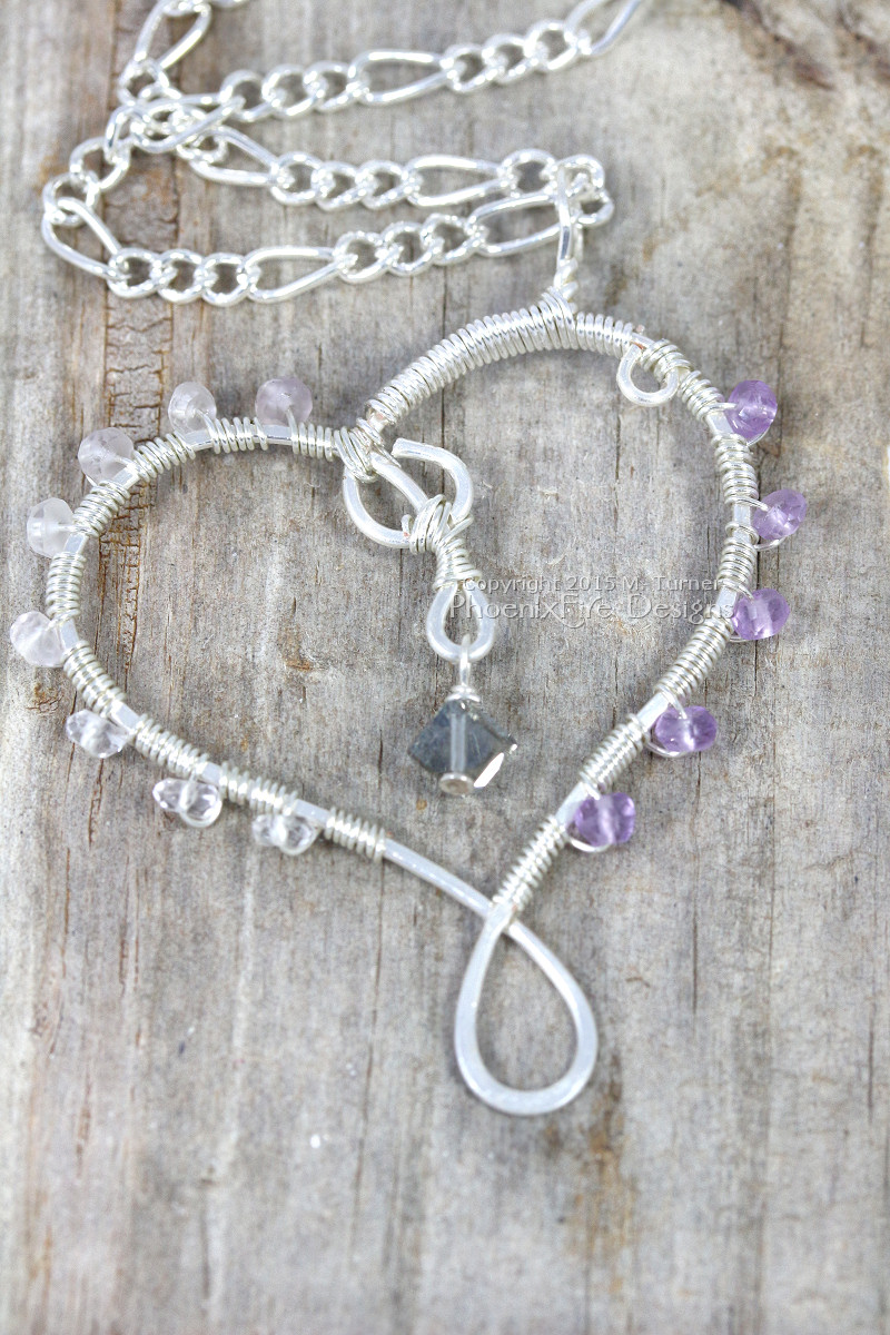Silver wire wrap heart pendant wrapped in amethyst and accented with color-changing swarovski crystal on figaro chain by PhoenixFire Designs on etsy