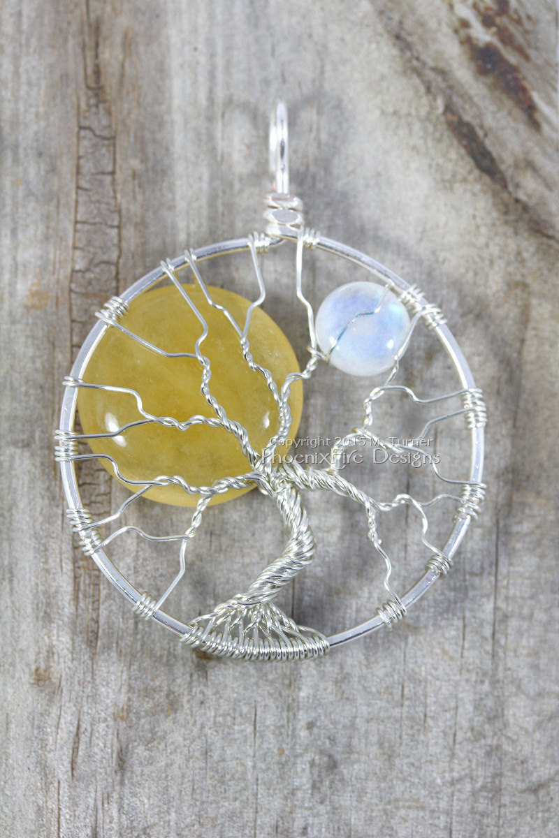 Celestial sun and moon tree of life pendant silver wire wrapped tree handmade yellow jade sol and natural blue flash rainbow moonstone by PhoenixFire Designs on etsy.