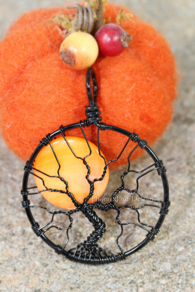 Spooky Halloween Full Moon Tree of Life Pendant with orange harvest moon wire wrapped in black wire by PhoenixFire Designs.