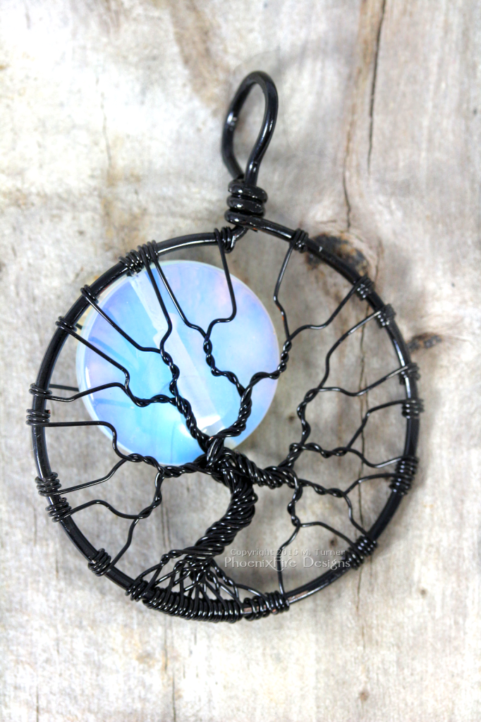 Handcrafted black wire wrapped opalite rainbow moonstone full moon tree of life pendant - the best seller by PhoenixFire Designs on etsy.