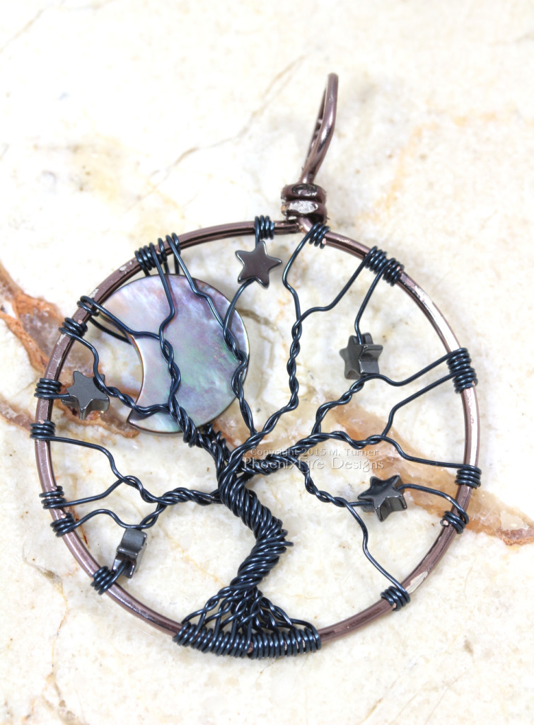 Wire wrapped in silver plated gunmetal wire, this celestial tree of life features an iridescent black lip shell crescent moon and hematite stars by PhoenixFire Designs on etsy.