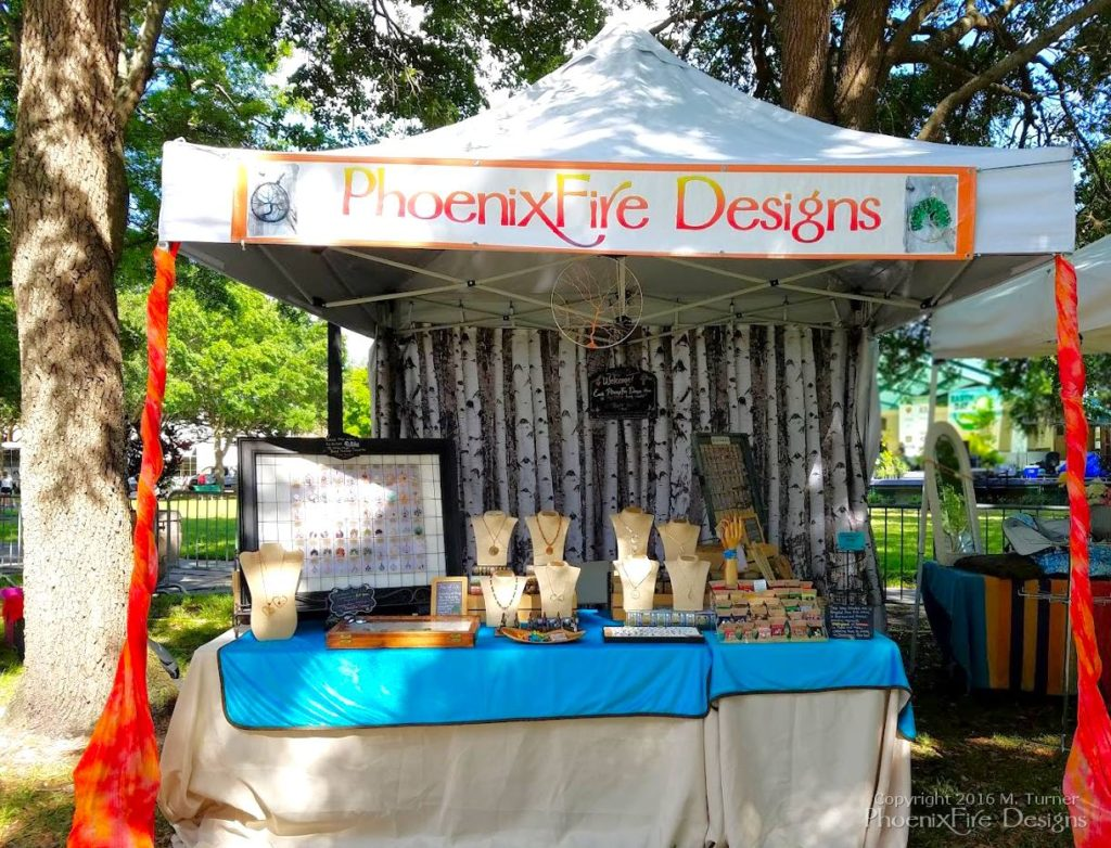 PhoenixFire Designs booth tent display for St. Pete Earth Day Celebration 2016.