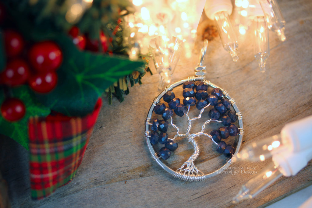 Argentium sterling silver, recycled and eco-friendly sterling with deep blue sapphire gemstones in this handmade tree of life pendant by PhoenixFire Designs.