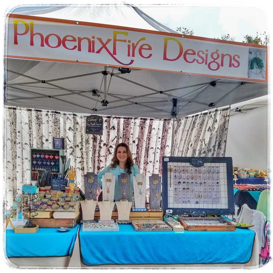 May Turner of PhoenixFire Designs inside our show booth tent. Find us at local festivals, markets, and fairs throughout Tampa Bay!