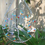 "Silver anodized aluminum wire wrapped tree of life 8"" suncatcher with rainbow glass fire cracked beads, perfect garden art, or handmade wall art for your home. By PhoenixFire Designs."